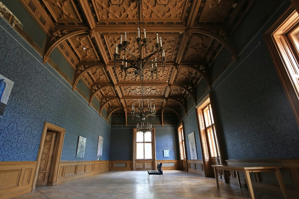 painting exhibition in a blue manor hall
