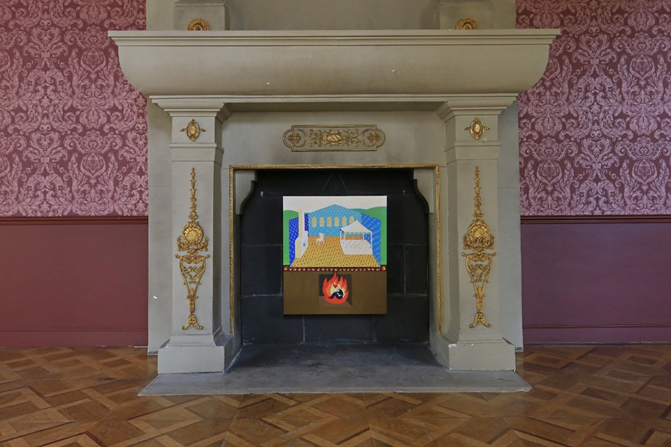 figurative decorative artwork with fire and gnome exhibited in fireplace at manor hall