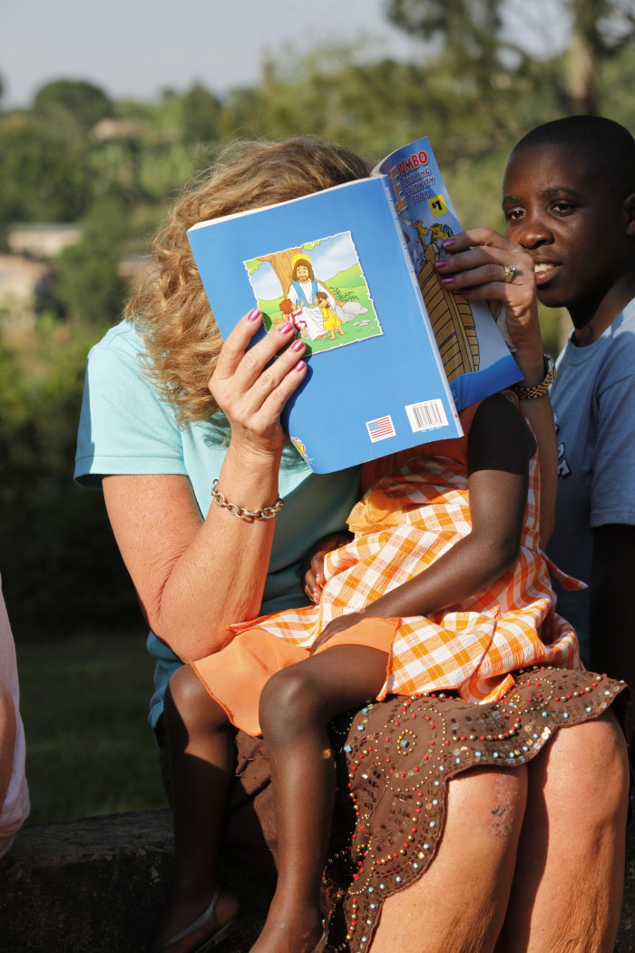 Beth reading to a child in Africa