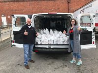 feedmore van driver volunteers delivers meals to children