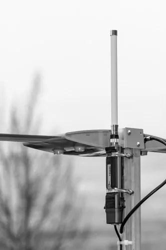 WiFiRanger Elite mounted on a batwing TV antenna.