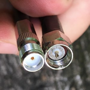 An SMA-Female (left) and SMA-Male (right) connector, side-by-side.