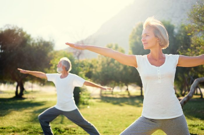 older adult couple doing yoga maybe after cbd