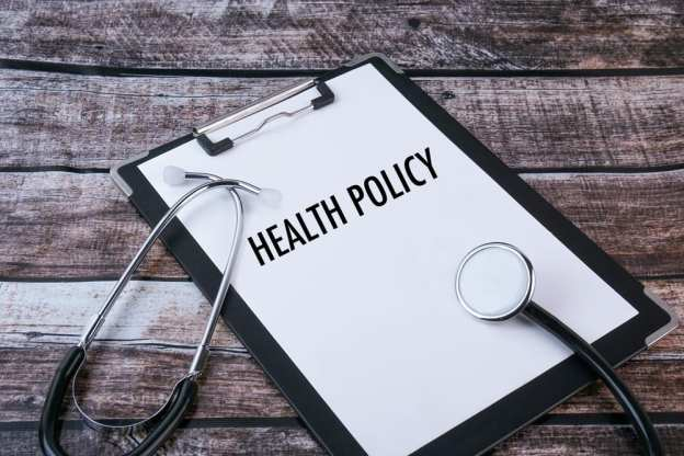 Clipboard with Health Policy Written on it and Stethoscope Beside