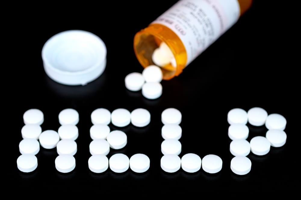 "Pills Spelling the word ""help"""