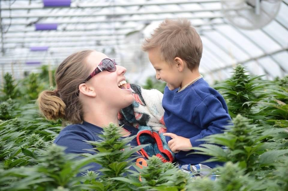 photo of landon riddle and mom in cannabis greenhouse