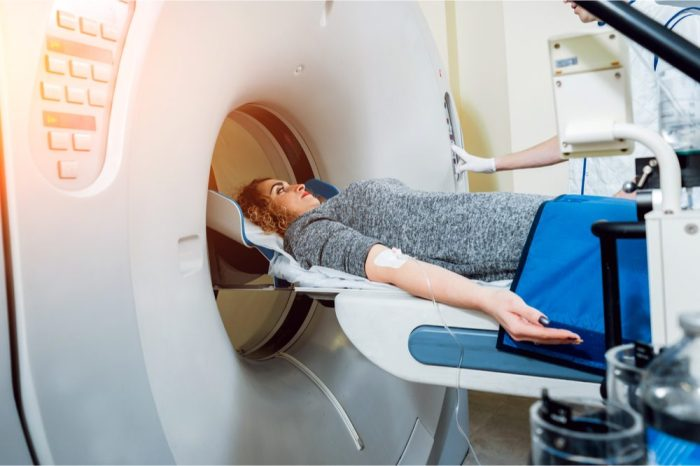 young woman in CTS scan for TBI