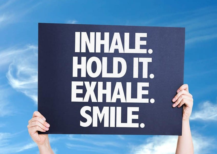 Sign that reads: inhale. hold it. exhale. smile