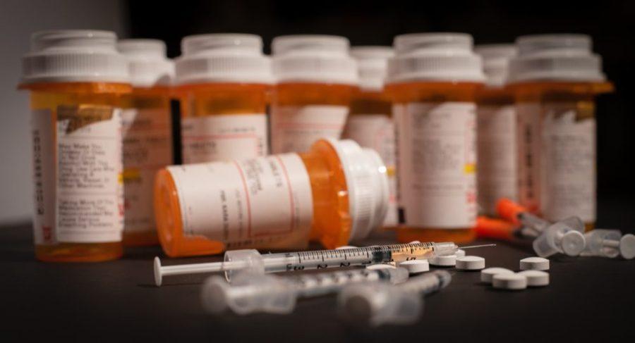 Opioid pill bottles and spilled pain meds
