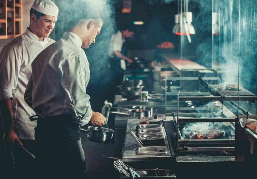 Chefs Working in a kitchen on the line