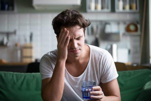 alcohol damage giving young man a headache