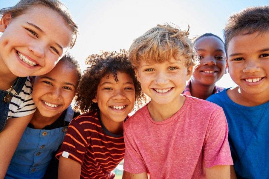 Happy kids peering in the camera CB1 receptors