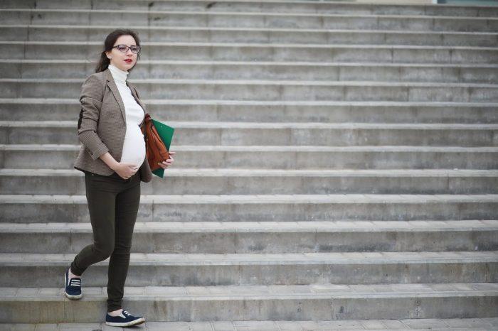 pregnant woman walking down steps