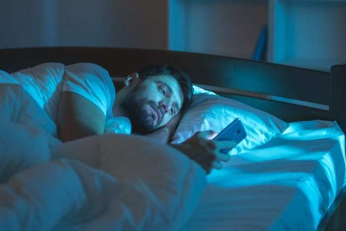 Man awake in middle of night looking at phone didn't take best edibles for insomnia