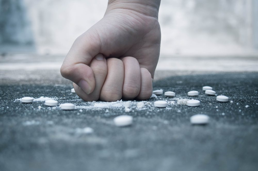how to get off benzos represented by fist crushing pills into the ground