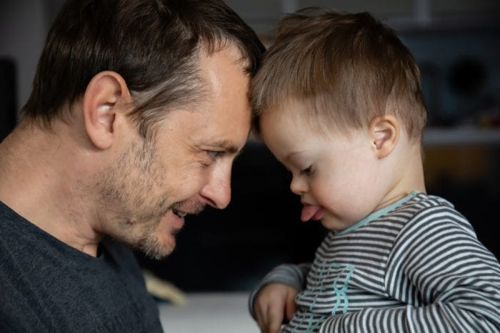 Dad playing with son who has trisomy 21