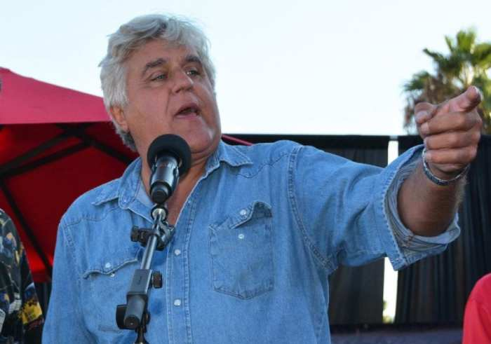 Jay Leno speaking at a podium about his hemp car