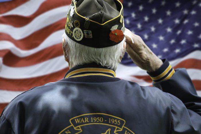 veteran salutes the flag
