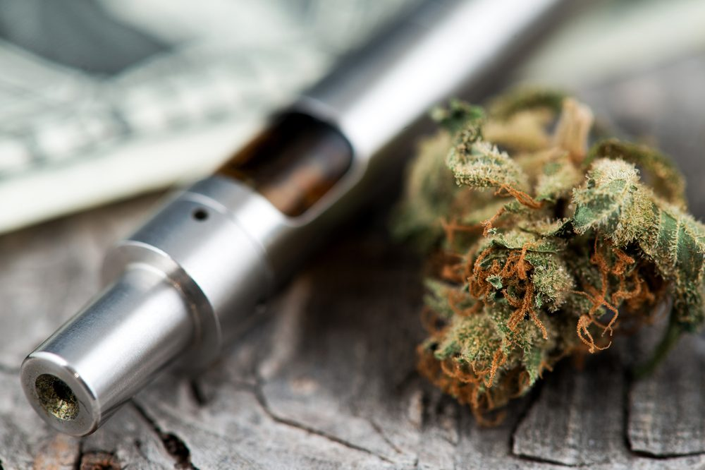 cannabis bud and vaporizer