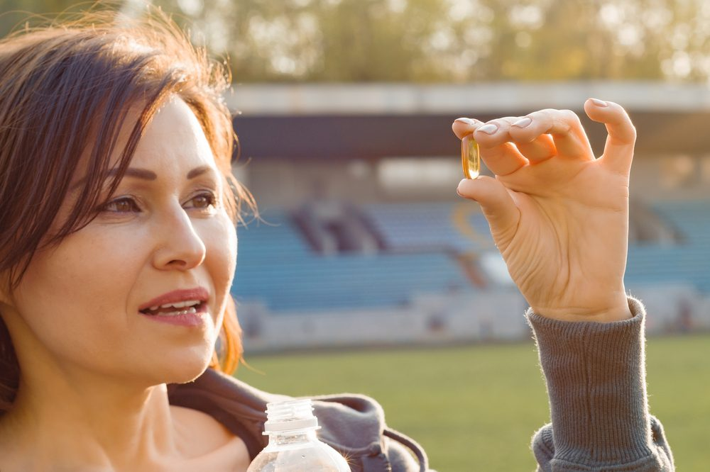 cbd bioavailability concept suggested by woman holding cbd capsule