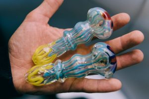 is a glass pipe like this one in a man's hand ilelgal? probably.