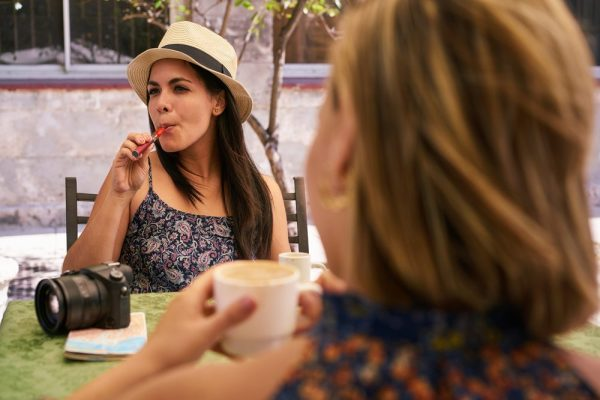 smoker friendly concept represented by young women smoking on patio