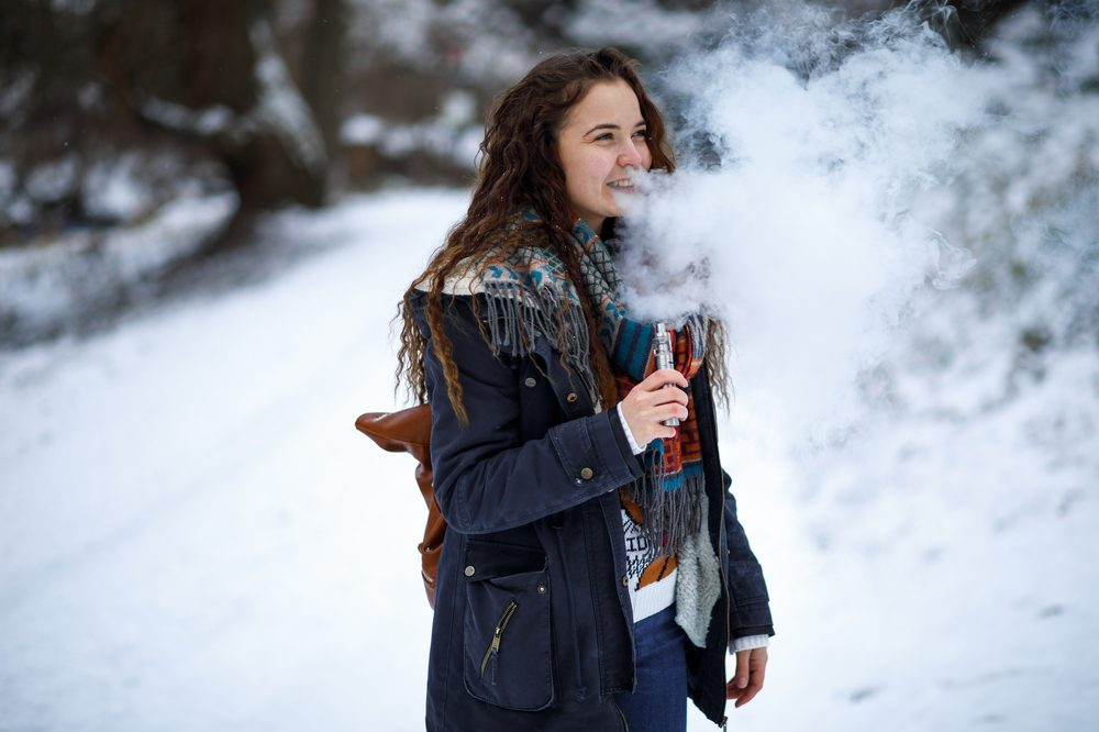 CBD crystals being vaped by girl out in the snow
