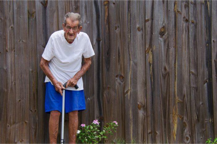 frail older adult uses cane