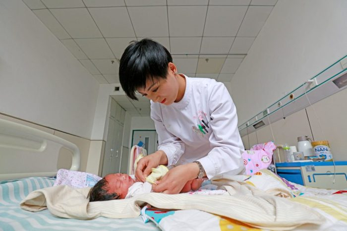neonatal checkup done by a nurse on a young baby to determine any changes of death