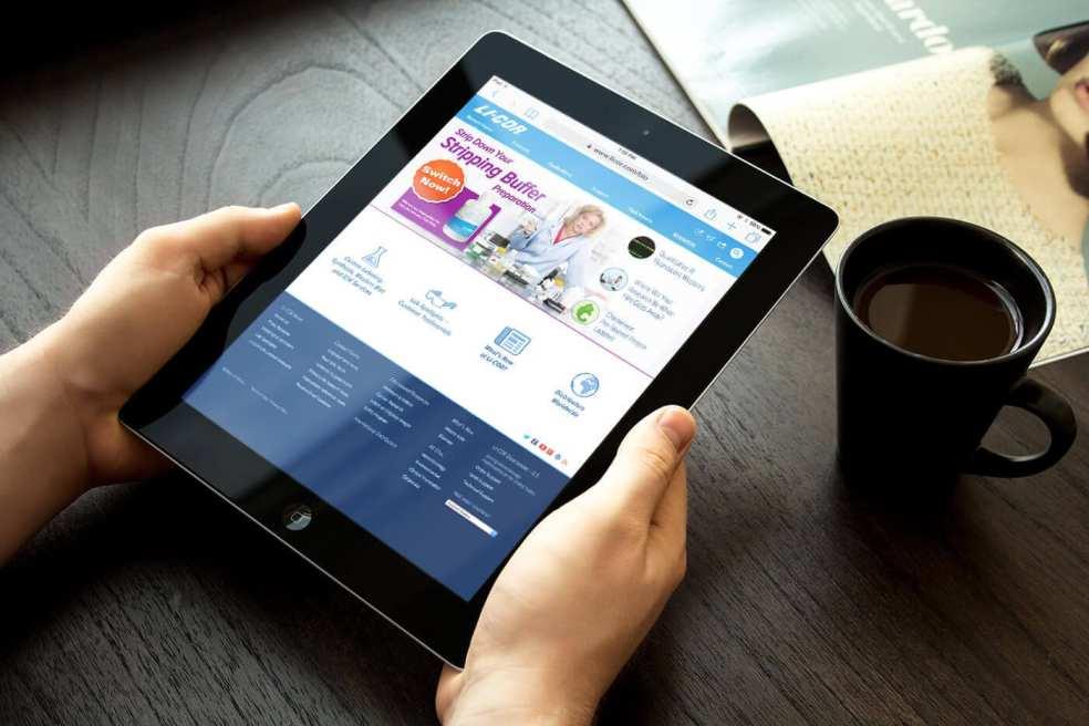 LI-COR Bio Home Page Redesign holding iPad mockup