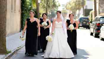 Bridesmaids walking down street in downtown Charleston, SC