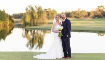 Bride and groom with a reflection in the lake - Members Club - Grande Dunes
