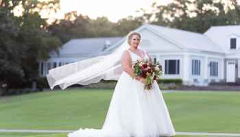 Bride with veil flowing behind her Pawleys Plantation Golf & Country Club
