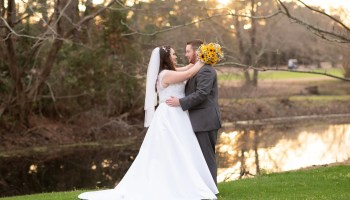 Bride with her arms around the grooms neck Litchfield Country Club