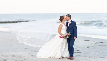 Bride and groom kissing with blowing veil - Pelican Inn - Pawleys Island