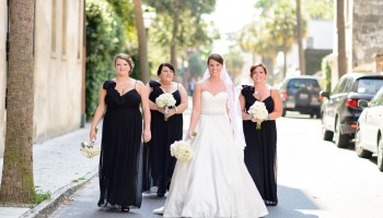 Bride walking down the downtown street with bridesmaids  - Charleston, SC