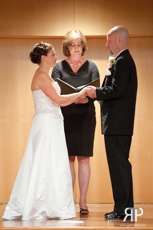 exchanging wedding vows at w.o smith music school