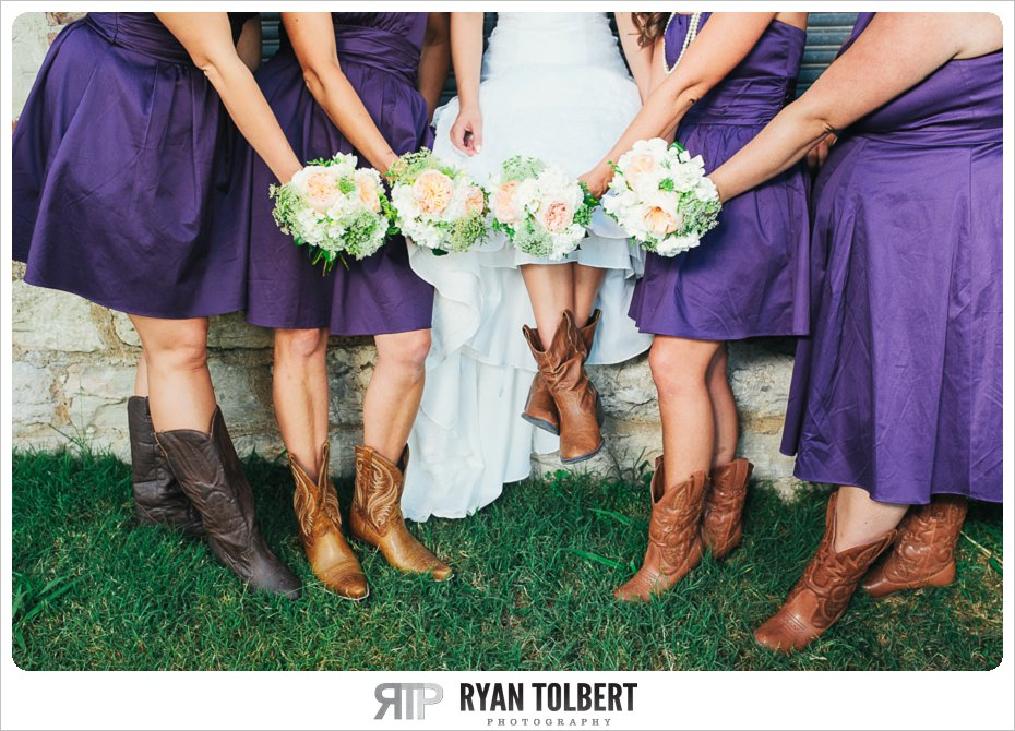 bride and bridesmaids with boots and bouquets