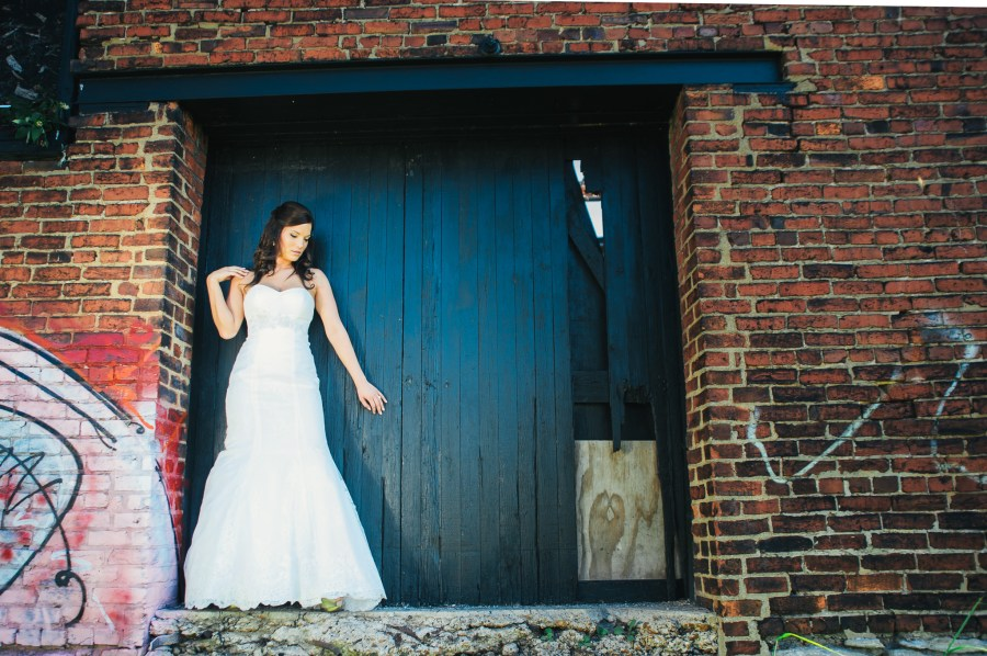 bride with rustic brick
