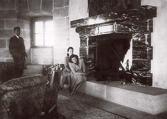 Gretl Braun with Christa Schroeder in front of the chimney at the Eagle's Nest. On the left the architect Albert Speer. This chimney was a gift to Hitler from Mussolini.