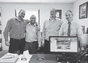 From left: Commissioner Chris Johnson, Government Information Services (GIS) representative Vito Charles, Commissioner Bruce Zagers and Island Governor Jonathan Johnson showing the new Government website.
