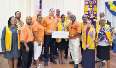 WIPM party members and Saba Lions Club representatives during the cheque presentation.