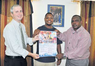 Saba Festival Foundation President Vito Charles (centre) officially presenting the 2016 Saba Carnival Schedule to Island Governor Johnathan Johnson (left) and Commissioner of Culture Rolando Wilson (right) on Wednesday.