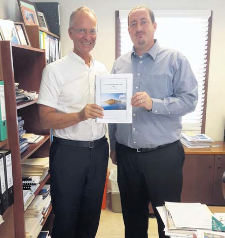Saba Commissioner Bruce Zagers (right) hands over the Tourism Action Plan 2016-2018 to Dutch Minister of Economic Affairs Henk Kamp on Monday.