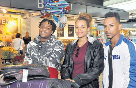 José Hupsel and Shaël Bennett from St. Eustatius, and Jordan Every from Saba after their arrival at Amsterdam Schiphol Airport Monday morning. (Suzanne Koelega photo)