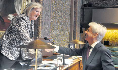 Dutch Minister of Home Affairs and Kingdom Relations Ronald Plasterk shakes hands with Chairperson of the First Chamber of the Dutch Parliament Ankie Broekers-Knol after Tuesday's plenary debate. (Suzanne Koelega photo)