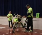 "Kent ""Schnak"" Schnakenberg shows off his bike, the T1Destroyer, to Rachel Enneking when speaking about bike safety."