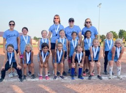 Members of the 8U Sabetha Blue softball team are FRONT ROW (L-R) Hannah Kroll, Henley Strahm, Alexis Ploeger, Eve Georg, Ashlynn Reed, Hazel Aberle and Ella Weldin; BACK ROW (L-R) Coach Greta Heiman, Faith Renyer, Emma Heiman, Charlee Ploeger, Issabella Pryor, Kindra McClain and Lillian Miller. Standing behind are Coaches Jenna McClain, Jennifer Ploeger and Michelle Georg. The team placed first in the tournament.