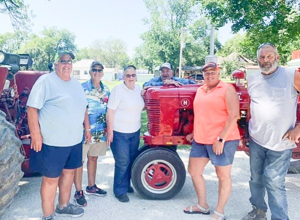 Members of the Aue family gather for a photo after the Tractor Cruise on Saturday, August 14.