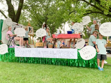 The Busy Jayhawkers 4-H Club stands with their Nemaha County Fair float.